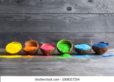 Bright colours in coconut shells for Indian holi festival. Colorful gulal (powder colors) for Happy Holi. - Shutterstock ID 1008317254