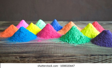 Bright colours for Indian holi festival. Colorful gulal (powder colors) for Happy Holi with copy space.