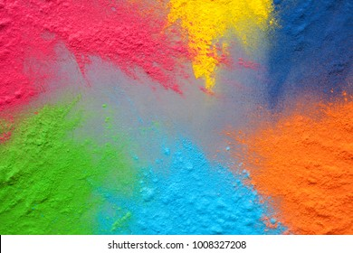 Bright colours for Indian holi festival. Colorful gulal (powder colors) splatted for Happy Holi with copy space.