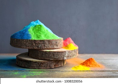 Bright colours on sawed wood for Indian holi festival. Colorful gulal (powder colors) for Happy Holi with copy space.