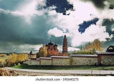 Bright contrasting sky over Orthodox monastery in autumn