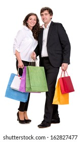 Bright couple with shopping bags on a white background
