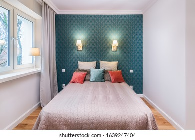 Bright and cozy elegant classic bedroom with elegant wallapaper and pillows on the bed