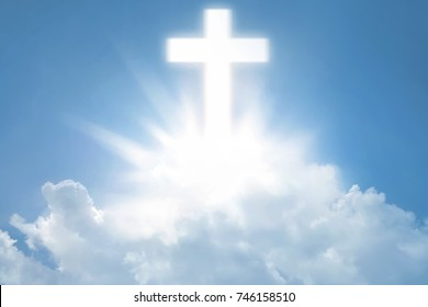 The bright cross over clouds at sky background