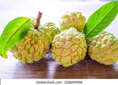 Bright custard apple fruits (sugar apple or sweetsop) on the wooden table