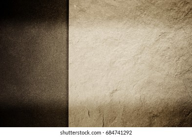 bright and dark toned rough stone background - copy space