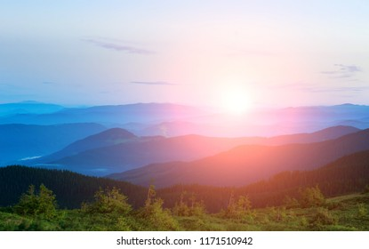 Bright dawn over the mountain peaks, beauty and purity of nature