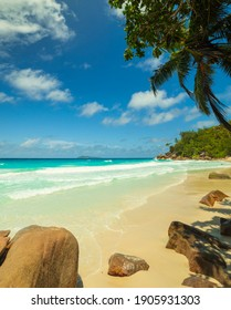 Bright daytime views of Anse Georgette paradise beach on the west coast of Praslin Island in the Seychelles