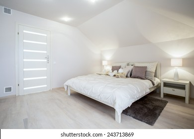 Bright delicate bedroom with spacious bed, horizontal
