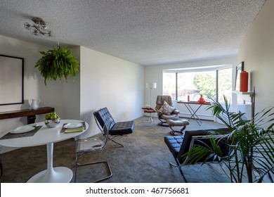 Bright dining room with a table set for dinner and a living room. Interior design.