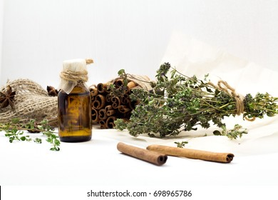 Bright dried medicinal herbs for cosmetic and healthcare use. Apothecary aroma dropper bottles. Natural herbal body balm