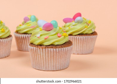 Bright Easter cupcakes with decorations close up