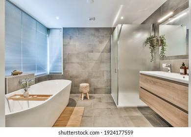 Bright elegant bathroom interior in a luxury house