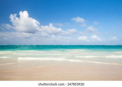 Bright empty beach, coastal landscape. Atlantic ocean coast, Dominican republic. Punta Cana