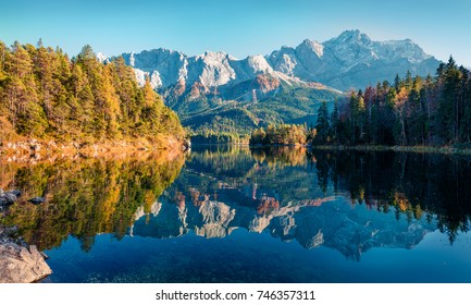 Bright evening scene of Eibsee lake with Zugspitze mountain range on background. Beautifel autumn view of Bavarian Alps, Germany, Europe. Beauty of nature concept background.