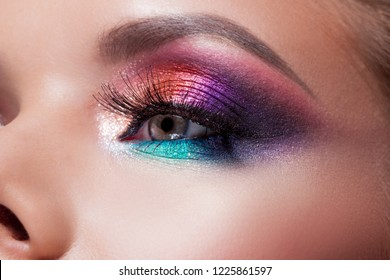 Bright eye makeup. Pink and blue color, colored eyeshadow. Close up