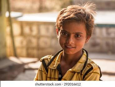 Bright eyes of and Smile of an indian child in looking at camera. Lalitpur, Uttar Pradesh (India). 2 May 2012.