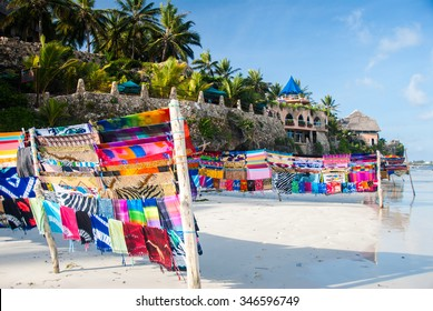 Bright fabric for sale on a white sand beach in a beautiful holiday location