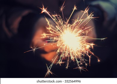 bright festive Christmas sparkler in hand toning