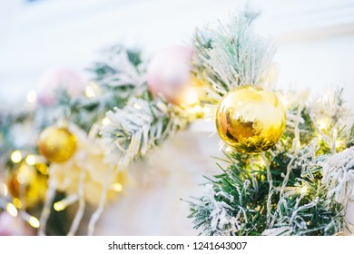 Bright festive decorations celebrating Christmas and New Year. Christmas toys, glass balls and garlands on the Christmas branches. Soft focus and beautiful bokeh.