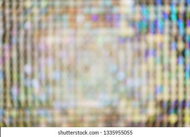 Bright, festive, sparkling, dazzling, abstract blurred background. Festive decorations and decoration of round shiny metallic sequins. Soft blur and small depth of field.