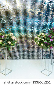 Bright, festive, sparkling, dazzling, abstract background. Festive decorations and decoration of round shiny metallic sequins. Soft blur and small depth of field.