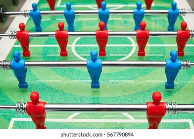 Bright figures table football players. Football field