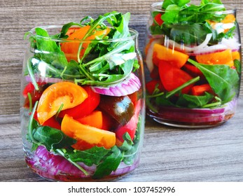 Bright fitness salad in the jar. The concept of nutrition for beauty and harmony.