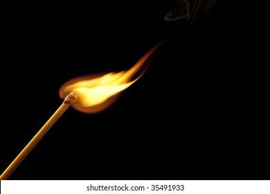 Bright flame on match stick