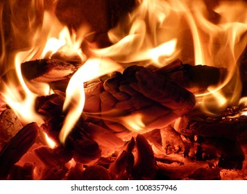 Bright flame in stove. Hot red charcoals and burning wood. Abstract fire background.