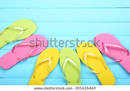 279765bec Bright Flip Flops On Wooden Background Stock Photo (Edit Now ...
