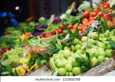 Bright fresh vegetables and fruits on the counter of the street night market. Vegetarian diet ingredients and foods for nutrition. Soft focus and beautiful bokeh.