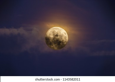 Bright full moon against dark clouds