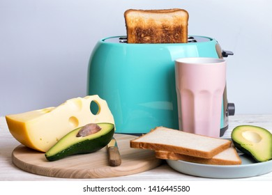 bright, fun breakfast. cyan color toaster on a wooden background