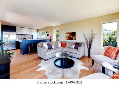 Bright furnished living room with mocha furniture and rug great match with black wood kitchen room