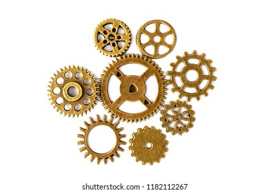 bright gears on white background, lots of round gears with brass color