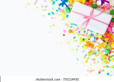 Bright gifts for a party, birthday or a new year. Confetti, stars, garlands, crackers.