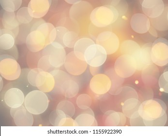 Bright glowing gold yellow celebration background with round blurred lights and glittering sparkling highlights