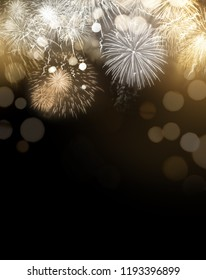Bright gold dazzling Fireworks display celebrations background with copy space.