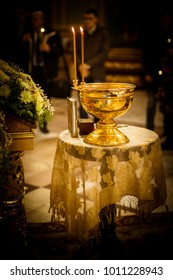 Bright Golden Bowl, candles on a church table.