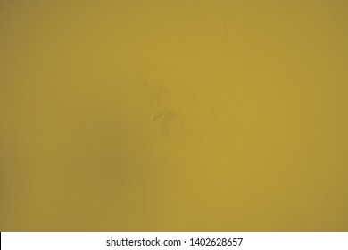 Bright golden plastered with rough structures concrete wall in industrial design. Creative element in pastel colors as background and for artistic collages. Structure wall in portrait format.