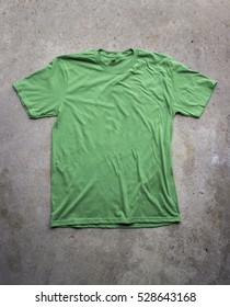 Bright Green Blank T-Shirt for Mock Ups on Concrete Background