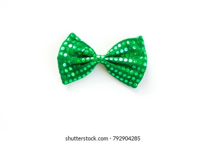 Bright green bow tie with sequins for St. Patrick's Day isolated on white