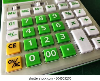 Bright green calculator for economy and business sign