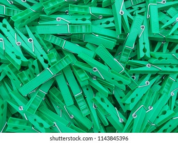 Bright green clothespins scattered on the table. View from above. Wonderful background with clothespins.