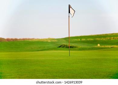 A bright green golf course
