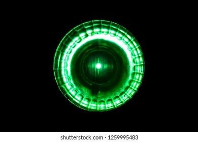 Bright green light close-up. Background is Black.