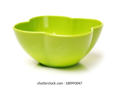Bright green plastic empty bowl on a white background