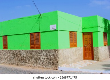 Bright green walled house with brown door and windows, Cape Verde architecture, Africa