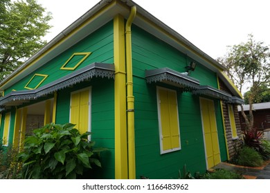 Bright green and   yellow typical house on the tropical island of La Reunion, France